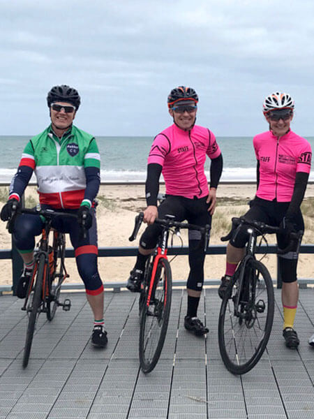 Couple in Pink Staff Cycling Kit